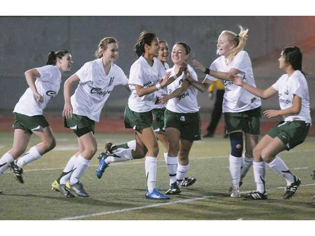 Members of the Canyon girls soccer team celebrate after scoring a goal this past season. The Cowboys finished league play 7-1-2, tying with Valencia on the last day of the regular season to split the Foothill League championship. Canyon advanced to the second round of the CIF-Southern section Division II playoffs.