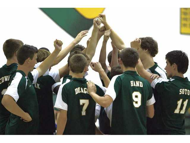 Members of Canyon's boys volleyball team huddle this spring. The Cowboys finished second in the Foothill League and reached the CIF-Southern Section Division II playoffs.