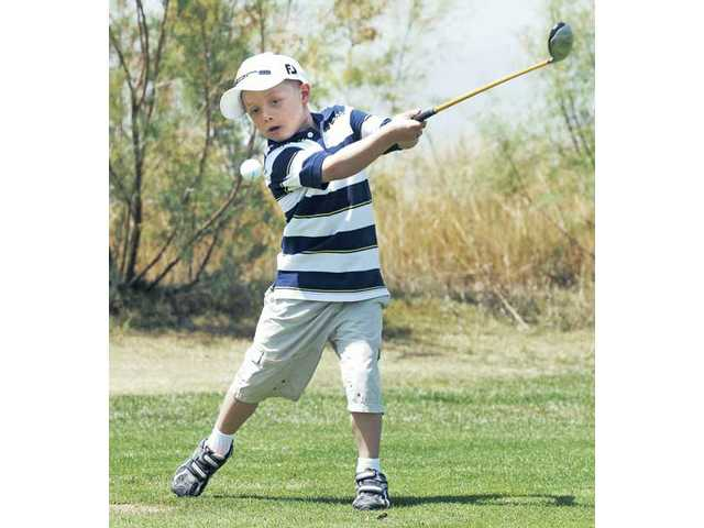 Cordova, of Valencia, uses his natural swing to tee off at the driving range at TPC golf course. Cordova and his family have received support from the Michael Hoefflin Foundation for Children's Cancer. He was diagnosed with non-Hodgkin lymphoma at the age of 4.