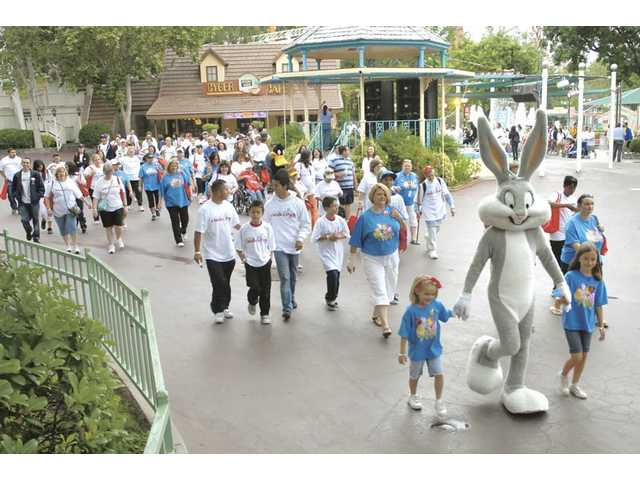"Bugs Bunny joins hundreds of walkers as they start the ""A Walk in the Park"" event at Six Flags Magic Mountain on Saturday."