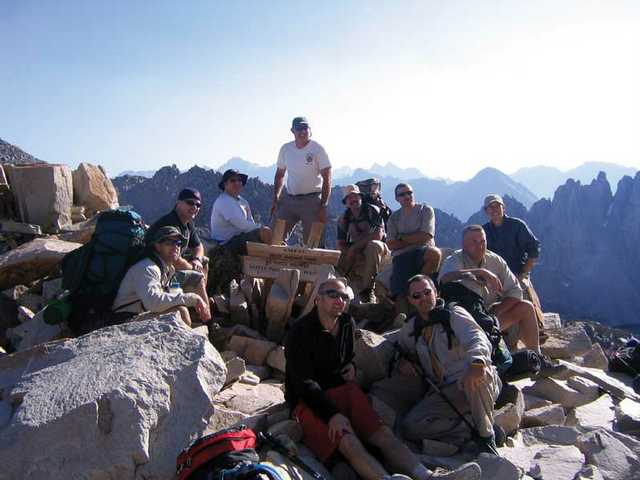 A group of hiking firefighters take a break at Kearsarge Pass Summit in July 2007.