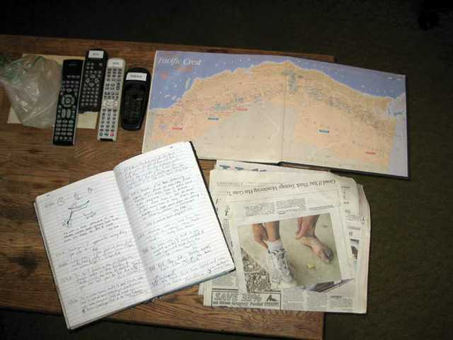 A sign-in journal, a map of the Pacific Crest Trail, and an article on foot problems are some of the many hiking-related items at the Saufleys' home.