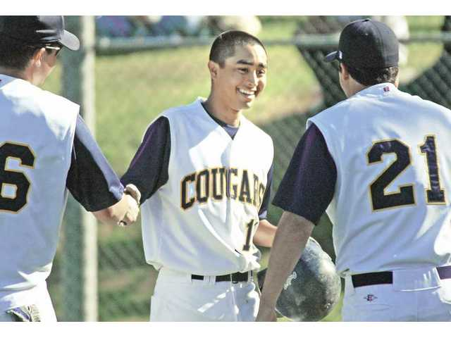 College of the Canyons outfielder Jason Okeefe, left, and Robbie Mousselli, right, congratulate infielder Kirk Corrales, middle, during their 21-5 win over West Los Angeles Community College on March 3. The Cougars finished the season with a 26-18-1 overall record.