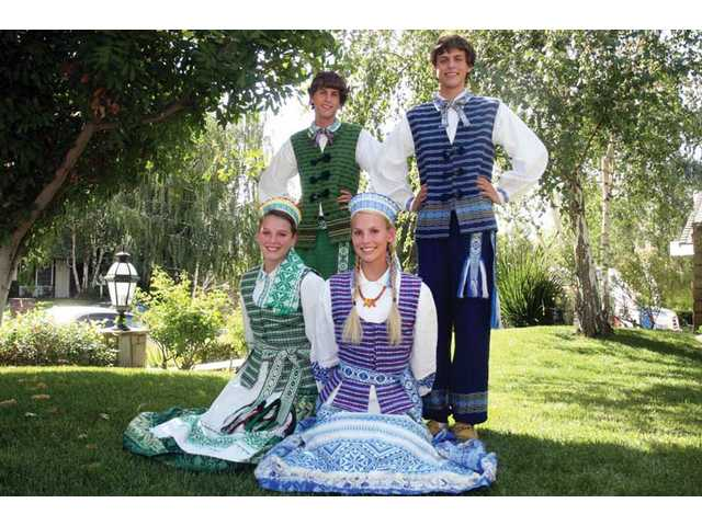 The Joga siblings Vik, 17, Gytis, 17, back row from left, Kriste, 13, and Karina, 16, front row from left, wear the traditional Lithuanian costumes they will be wearing in next month's Lithuanian Folk Dance Festival in Los Angeles.
