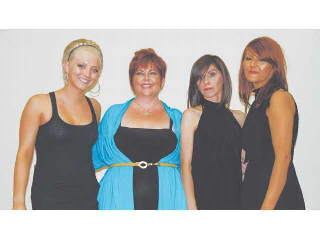 Kim Siojo, far left, assisted Shannon stylists including Angela Byrd, far right, in cutting, coloring and styling hair of Stina Garbis and Elizabeth Nunez, center.