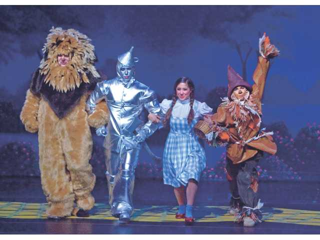 "Actors portraying the Cowardly Lion, Tin Man, Dorothy and Scarecrow perform Wednesday night at the dress rehearsal for ""The Wizard of Oz"" at the Santa Clarita Performing Arts Center."