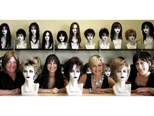 Godiva's Secret is a new wig store catering to women of all ages who want a different look or for those women going through chemotherapy. From right are Vanessa Wiesey, stylist, Rochelle Scott, owner, Danielle Scott, manager, and Ellen Bennett, stylist. All of the women are wearing wigs except for Danielle who is wearing extensions.