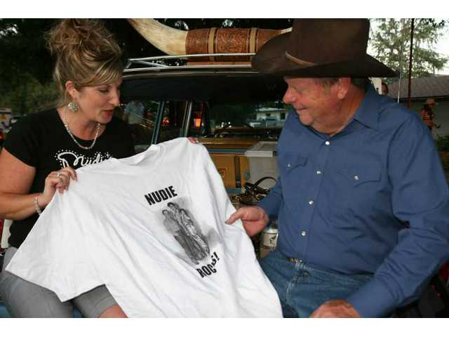 Jamie Nudie and Mayor Bob Kellar tailgate on her grandfather's duded-up '64 Pontiac at the second Evening Under the Oaks at Kellar's abode to benefit the Santa Clarita Symphony.