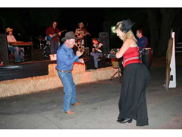 Mayor Bob Kellar and an Evening Under the Oaks guest work it on out as the McGrath Project and friends Miyuki Nakashima on violin, er, fiddle (cowboy hat), guitarist Michael Lynn (cowboy shirt), and gongero Allan Cameron.