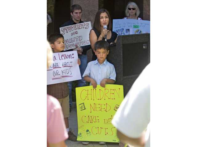 Erika Derry, mother of Cade, 9, and Owen, 7, shared how cuts in schools would hurt her sons during a campaign for a fair budget outside Assemblyman Cameron Smyth's office in Valencia on Thursday morning.