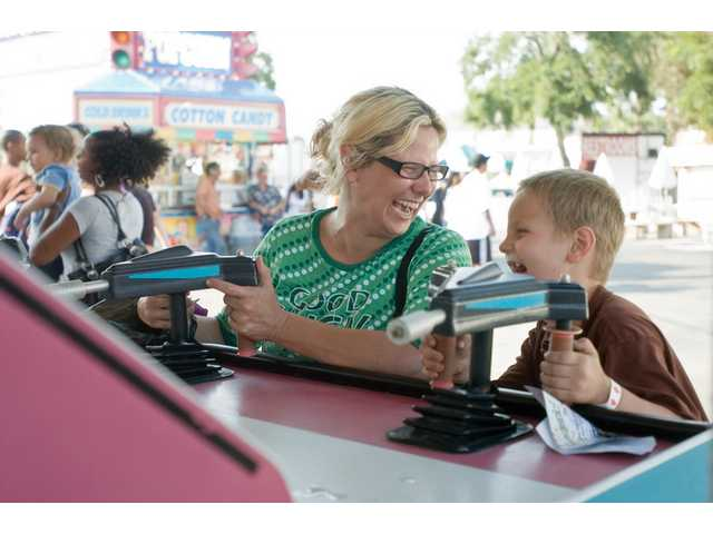 Michale Bowen with her son Donny from Frazier Park enjoys some of the games at the SCV fair on Thursday afternoon.