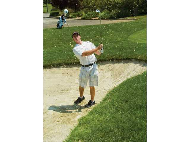 Nick Delio takes a few practice shots out of the bunker on Thursday at Valencia Country Club.