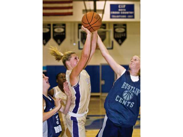 Valencia High girls basketball guard Lindsey Hill drives for two points but is fouled by Saugus' High Kaitlyn Smither in the second quarter of the Saugus Summer Tournament at Saugus High School.