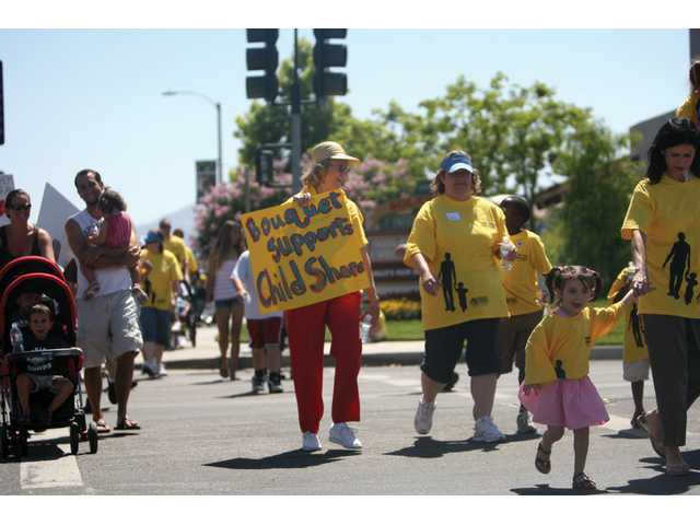 Participants of the Walk your Talk Walk make their way back to Bethlehem Lutheran Church in Canyon Country after walking a mile, Saturday morning. Local and people from outside Santa Clarita took part of the event.