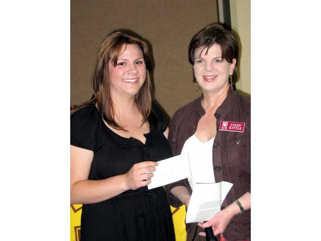 Allison Tamboline accepts her Young Women in Public Affairs scholarship check from Cindy Kittle at Zonta's recent business meeting.