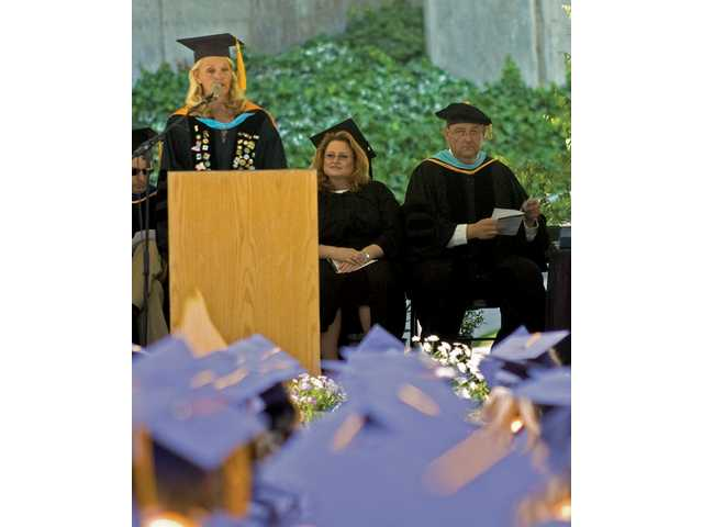 Dianne Van Hook presides over the graduation ceremony for the class of 2008. She marks 20 years as president of the community college today.
