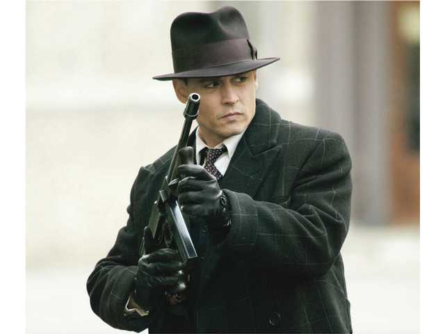 "Johnny Depp portrays John Dillinger in the Michael Mann film ""Public Enemies,"" which opened Wednesday."