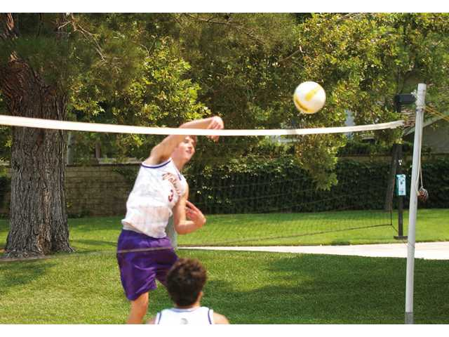 Valencia outside hitter and Signal Boys Volleyball Player of the Year Jim Baughman launches a hit recently at Del Monte Recreation Park.