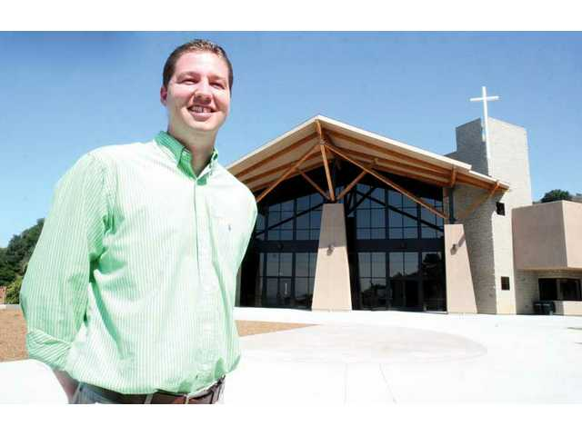 Senior Pastor Steve Jackson stands in front of Faith Community Church's new 23-acre spread in Newhall.