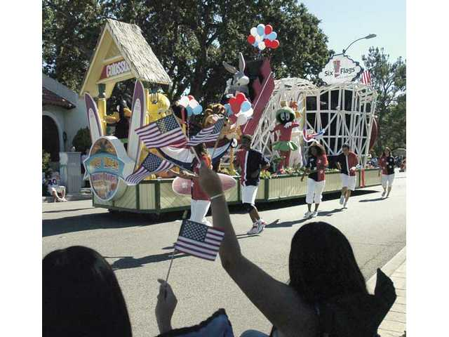The Six Flags dancers and the Six Flags Colossus float roll down Lyons Avenue during the 2009 SCV Fourth of July Parade on Saturday.