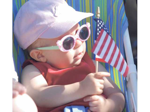Taylor Zahrt, 1, watches for horses in the 2009 SCV Fourth of July Parade on Saturday.