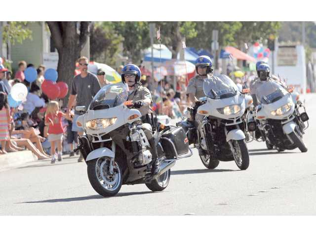 California Highway Patrol officers perform maneuvers on their motorcycles at the 2009 SCV Fourth of July parade on Saturday.