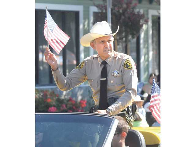 Los Angeles County Sheriff Leroy Baca waves his flag in celebration of Independence Day.
