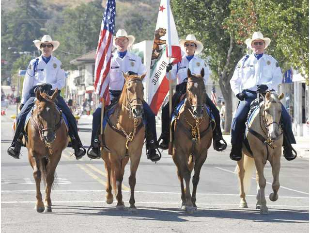 L.A. County Sheriff's Mounted Posse carries the colors which started the Fourth of July Parade on Saturday.