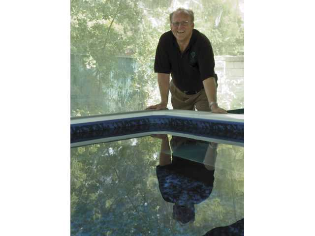 B.J. Atkins' pool uses the sun's power to heat the water.