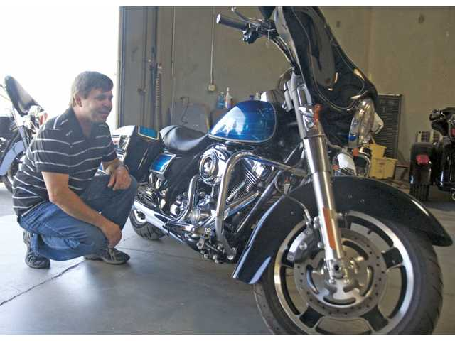 Jacob Meyer, of Valencia, admires his brand new, custom-made Harley-Davidson Street Glide motorcycle he purchased Friday afternoon. A new Harley-Davidson dealership opened on Centre Point Parkway on June 19 after spending more than four decades in the San Fernando Valley.