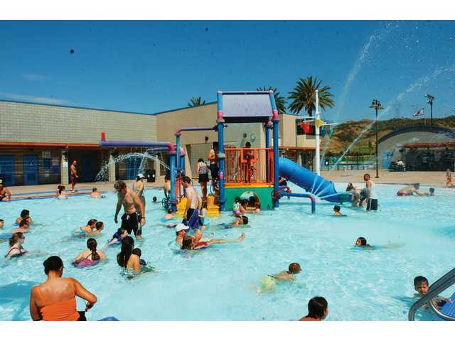 Families have fun in the sun at the Santa Clarita Aquatic Center in June. Playing in the pool is a cool way to get kids off the couch, and away from the television and video games this summer.