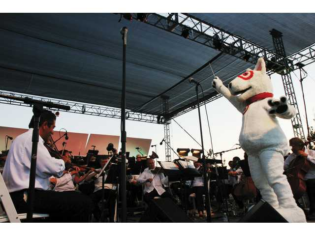"Target stores underwrote most of the Santa Clarita Symphony's performance at Concerts in the Park Saturday evening, so Target mascot Bullseye the Dog got to be a guest conductor for ""76 Trombones,"" from ""The Music Man."""