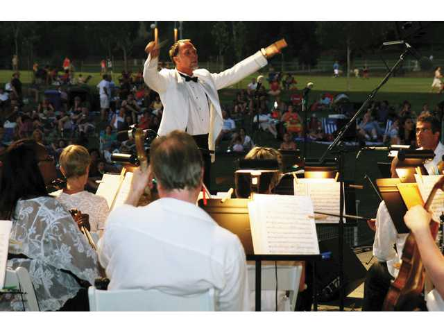 Maestro Robert E. Lawson conducts the Santa Clarita Symphony as they perform an all-American program at Concerts in the Park Saturday evening.