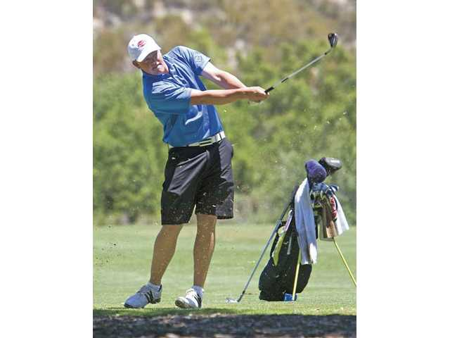 West Ranch junior J.J. Holen takes a swing on the 15th hole Tuesday at Robinson Ranch Golf Course.