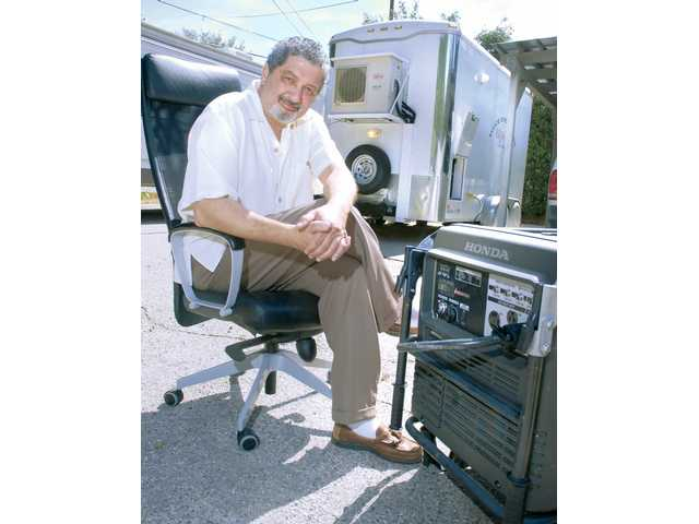 Voice Over There CEO Amir Soleimani sits in front of his self contained mobile recording studio trailer in Newhall on Wednesday.
