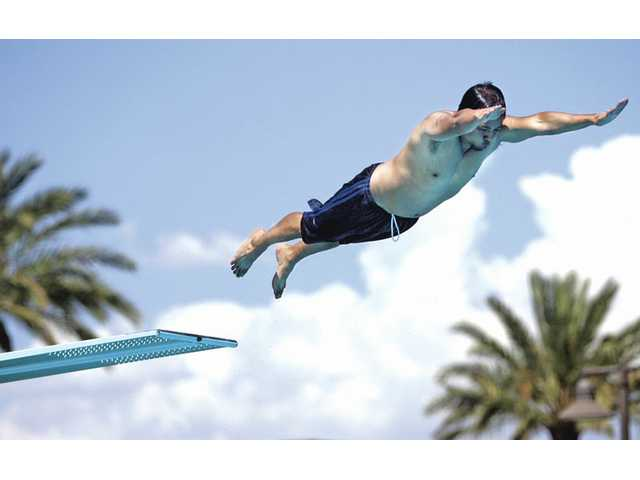 A diver arches off the high dive at the Santa Clarita Aquatics Center.