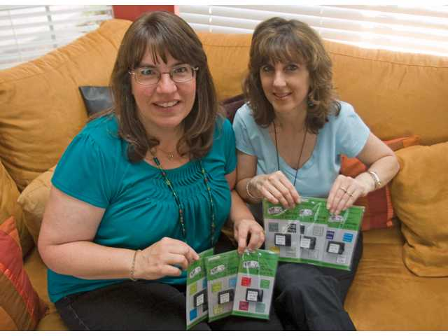 Lori Gardner and Susan Bibicoff have invented Scrap Tunes, a light-activated, prerecorded musical embellishment for the scrapbooking industry. Gardner and Bibicoff have been friends for 23 years.