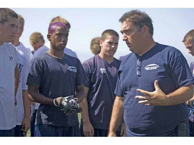 West Ranch football head coach Sean O'Brien, right, talks with his team during practice Thursday at West Ranch High School.