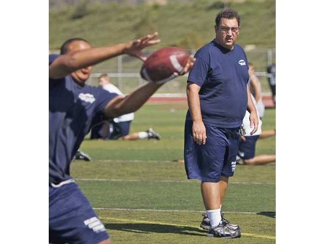 West Ranch football head coach Sean O'Brien, right, watches his players during practice Thursday at West Ranch High School. O'Brien is the second varsity head coach in school history