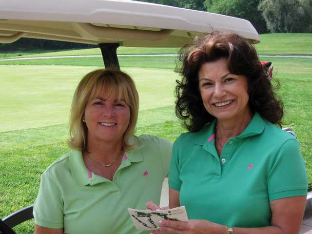 Diana Ayres, left, and Anna Ott are co-chairs of the Going Green Fore the Kids event, which takes place next Monday at the Tournament Players Club in Valencia. The event will raise money for the Child & Family Center, now in its 32nd year of operation.