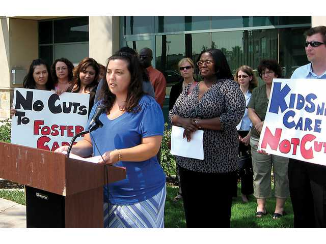 Social worker Naomi Senft spoke at the Santa Clarita Department of Children and Family Services office in Valencia on Thursday to voice concerns about proposed state budget cuts to foster care programs.