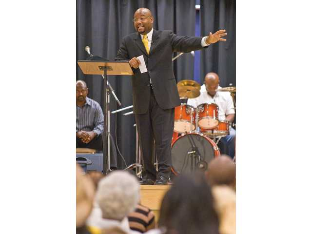 Paston Marlon Saunders gives s a sermon in front of hundreds during services at the Valencia Christian Center in Stevenson Ranch.