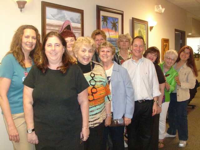 Staff and patients alike enjoy the works of SCAA members displayed at Artistic Smiles dental office in Valencia.