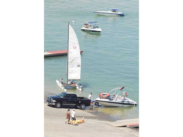 Pleasure boats launch from the main Castaic boat launch on Saturday.