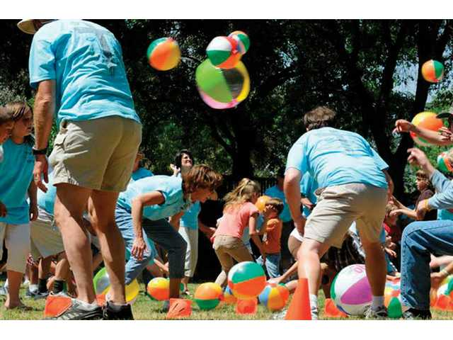 At times, the church family members playing Cleaning the Yard had more balls in the air than on the ground. Rev. Bill Barnes, pastor for First Presbyterian Church in Newhall, explained that the two sides had to clean their yard by throwing the beach balls into their neighbor's yard. The game was a wild party itself.