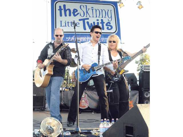 "From left, Mike Pieper, Rich Morlock and Shellie Dorman of the Skinny Little Twits perform ""Free Ride"" at the Concerts in the Park held at Central Park on Saturday night."
