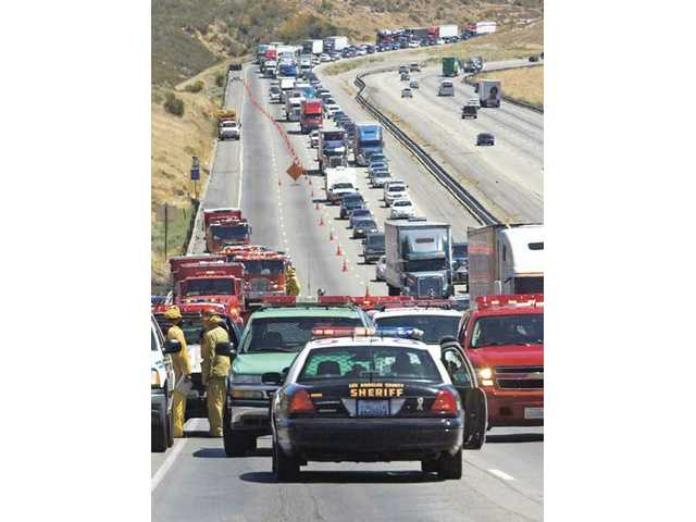 After a wildfire broke out Monday afternoon in the Osito Canyon area near Pyramid Lake, CHP officers closed the number three and four lanes of northbound Interstate 5, and plan to keep them closed overnight.