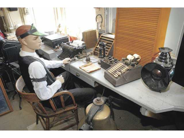 A mannequin sits in vintage clothes at the desk of a railroad agent for an exhibit at the Saugus Train Station at Heritage Junction Historic park. The display reveals the tools used by early railroaders. The train station opened on Sept. 1, 1887, and closed Nov. 15, 1978.
