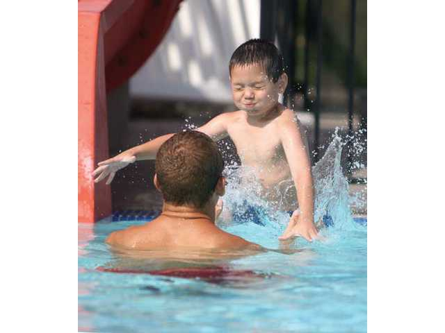 Five-year-old Zack Vasquez jumps into the arms of lifeguard and swim instructor Jason Medly, at the SCV Aquatic Center on Thursday morning.