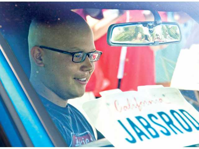 With more than 80 friends and supporters watching, Saugus High School senior Jonny Borondy gets behind the wheel of his newly restored and customized 1968 Chevrolet El Camino.